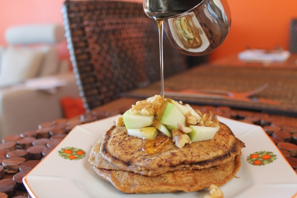 Vegan pumpkin pancakes - pouring maple syrup